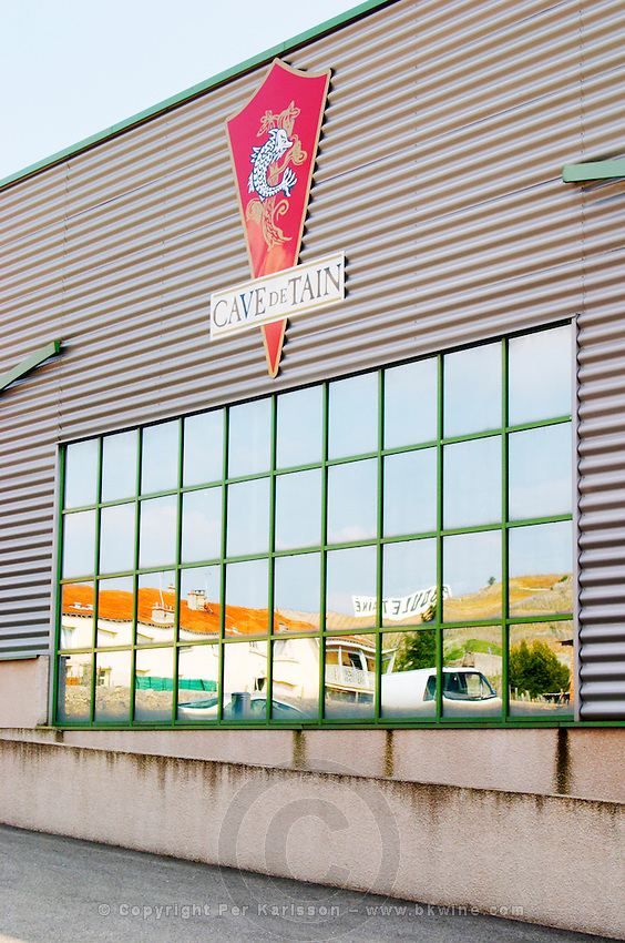 The cave cooperative co-operative wine producer Cave de Tain in Tain l'Hermitage. The modern winery building. The hermitage vineyard reflected in the window of the winery. Tain l'Hermitage, Drome, Drôme, France, Europe