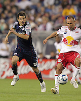 New York Red Bulls midfielder Joel Lindpere (20) attempts to collect failed Revolution pass. The New England Revolution defeated the New York Red Bulls, 3-2, at Gillette Stadium on May 29, 2010.