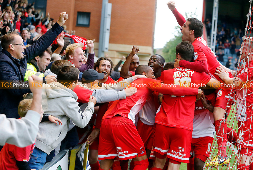 O'S PLAYERS &amp; FANS GO CRACKERS AFTER KEVIN LISBIES LATE WINNER<br /> - Leyton Orient vs Port Vale - SkyBet League One Football Match at the Matchroom Stadium, Brisbane Road, Leyton, London - 14/09/13 - MANDATORY CREDIT:Simon O&quot;Connor/TGSPHOTO - Self billing applies where appropriate - 0845 094 6026 - contact@tgsphoto.co.uk - NO UNPAID USE