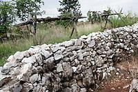 Museo all'aperto della Dolina del XV Bersaglieri, presso il monte Sei Busi. Questo Museo e' formato da tre doline (depressioni del terreno carsico). Camminamento scavato nel terreno, che permetteva di raggiungere le doline senza esporsi al fuoco nemico. Questi camminamenti erano anche una sorta di trincee (lo si evince dai cavalli di frisia), dalle quali difendere le postazioni.<br /> The 'Dolina of the XV Beraglieri', next Mount Sei Busi. A trench excavated in the ground that allowed soldiers both to defend the position and to reach the near hospital being protected.<br /> Redipuglia 03-09-2014 Lungo tutto il confine del Friuli Venezia Giulia, e nella fattispecie nella zona del Carso isontino, si snoda quello che durante la Prima Guerra Mondiale, o Grande Guerra, era chiamato il fronte orientale, conteso tra l'esercito italiano e quello austro-ungarico. La zona del fiume Isonzo, obiettivo strategico, fu teatro di ben 11 battaglie e di una estenuante guerra di posizione, costata la vita migliaia di soldati. Numerose sono ancora le testimonianze di quei terribili giorni sulle colline isontine, per cui, con i patrocinio della comunit&agrave;' europea, sono stati costituiti dei veri 'musei all' aperto' con percorsi che permettono di visitare i luoghi pi&ugrave;' importanti di quelle battaglie.<br /> Along the northern borders of Friuli Venezia Giulia, Italy, was part of the called Eastern Front during the 'World War I' also said the 'Great War'. The Isonzo river, a strategic target, was theatre of 11 battles between italian and Austro-Hungarian troops, where hundred thousand soldiers lost their lives. <br /> To remember that war, a series of 'open air museums' where established, along the most important places where the battles took place and where is still possible to see trenched systems, hospitals, mass graves, barbed wire ecc.<br /> Photo Samantha Zucchi Insidefoto