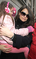 NEW YORK, NY - JANUARY 2: Katie Holmes and Suri Cruise arriving to her Broadway play Dead Accounts at the Music Box in New York City. January 2, 2013. Credit: RW/MediaPunch Inc.