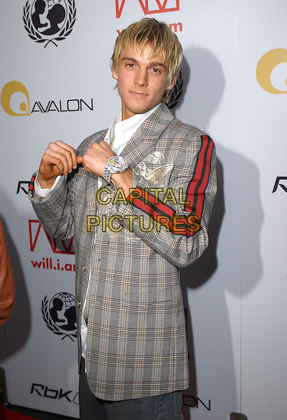 AARON CARTER.Will.i.am Music Group and RBK's Tsunami Relief Benefit Concert held at Avalon in Hollywood, California .February 11th, 2005.half length tweed plaid striped jacket embroidery hands fists watch gesture.www.capitalpictures.com.sales@capitalpictures.com.Supplied By Capital PIctures