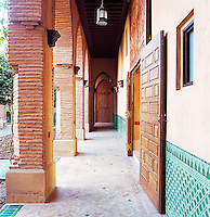 Green glazed tiles decorate the bottom half of the walls enclosing the inner courtyard