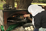Israel, Mount Carmel, Druze woman baking Pita bread.