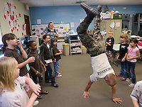 mr-cadets0530   159009-  Arizona Project challenge cadet Michael Jensen walks on his hands while helping out in a K-2nd grade class at Sequoia Charter School. Jensen was participating in a dance line that was part of class. Project Challenge provides a live-in military based education for high school drop outs.  Michael Jensen, of Gilbert, will be the first Arizona Project Challenge cadet to graduate with a high school diploma from Sequoia Choice Arizona Distance Learning in Mesa. (Pat Shannahan/ The Arizona Republic)