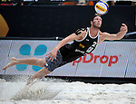 ST. PETERSBURG, FL - JUNE 18:  Sam Schachter of Canada dives for the ball during the FIVB Beach Volleyball World Tour St. Petersburg Grand Slam presented by the AVP on June 18, 2015 at Spa Beach in St. Petersburg, Florida. (Photo by Donald Miralle for the AVP)