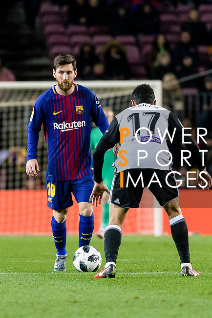 Lionel Messi of FC Barcelona (L) in action against Francis Qoquelin of Valencia CF (R) during the Copa Del Rey 2017-18 match between FC Barcelona and Valencia CF at Camp Nou Stadium on 01 February 2018 in Barcelona, Spain. Photo by Vicens Gimenez / Power Sport Images