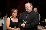Virginia Bazan accepts her award for Volunteer of the Year at the East Aldine Strategic Partner Awards from Chair Clyde Bailey
