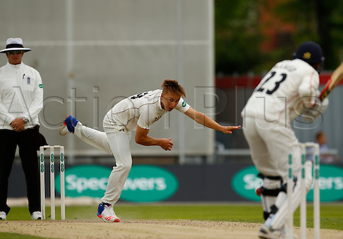 23.05.2016. Old Trafford, Manchester, England. Supersavers County Championship. Lancashire versus Surrey.  Surrey all-rounder Tom Curran bowls at Lancashire batsman Haseeb Hameed during the morning session.