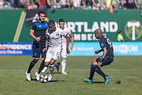 Portland, Oregon - Sunday October 6, 2019: Andy Polo #11 dribbles the ball between Valeri Qazaishvili #11 and Judson #93 during a regular season match between Portland Timbers and San Jose Earthquakes at Providence Park in Portland, Oregon.