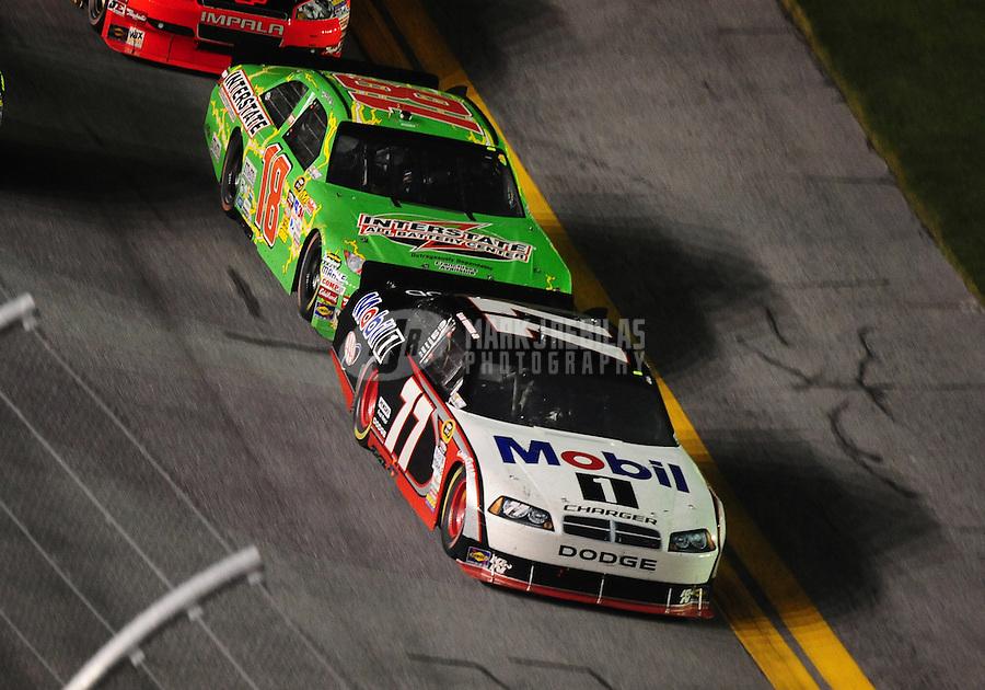 Jul. 3, 2010; Daytona Beach, FL, USA; NASCAR Sprint Cup Series driver Sam Hornish Jr. (77) leads Kyle Busch (18) during the Coke Zero 400 at Daytona International Speedway. Mandatory Credit: Mark J. Rebilas-