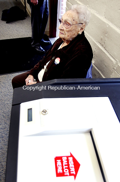 MIDDLEBURY CT. 26 April 2016-042616SV1-- Ann Scoffone watches voters cast their ballot at the Shepardson Center in Middlebury Tuesday. Republican Registrar Nancy Robison has enlisted the help of Scoffone, her mother, who will turn 100 on May 17.<br /> Steven Valenti Republican-American