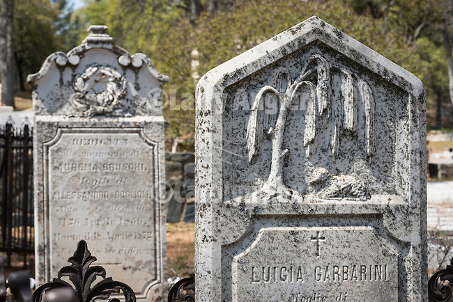 Headstones in the 19th century and historic Coulterville Cemetery in California's Mother Lode Gold Country..Luigia Garbarini