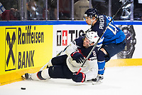 American Jacob Trouba (L) and Finland's Antti Pihlstrom fight for the puck during the Ice Hockey World Championship quarter-final match between the US and Finland in the Lanxess Arena in Cologne, Germany, 18 May 2017. Photo: Marius Becker/dpa /MediaPunch ***FOR USA ONLY***