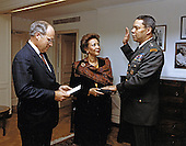 United States Secretary of Defense Dick Cheney (left) administers the oath of office to General Colin L. Powell, United States Army, Chairman, Joint Chiefs of Staff in Washington, DC on October 3, 1989.  General Powell's wife, Alma, is shown holding the Bible.<br /> Mandatory Credit: Helene Stikkel / DoD via CNP