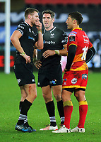 Gavin Henson of the Dragons (R) speaks with Dan Biggar and James Hook and Sam Davies of the Ospreys (R) during the Guinness PRO14 match between Ospreys and Dragons at The Liberty Stadium, Swansea, Wales, UK. Friday 27 October 2017