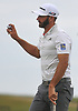Dustin Johnson acknowledges the cheers from the gallery after sinking a putt on the 17th green in the first round of the U.S. Open Championship at Shinnecock Hills Golf Club in Southampton on Thursday, June 14, 2018.