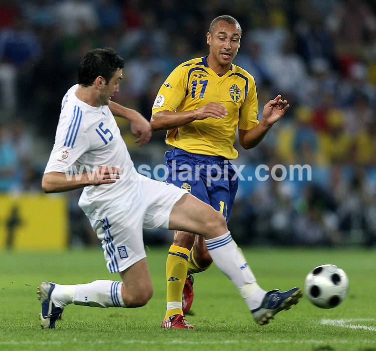 **ALL ROUND PICTURES FROM SOLARPIX.COM**.**SYNDICATION RIGHTS FOR UK AND SPAIN ONLY**.European Championship tournament Euro 2008, Greece versus Sweden at the Wals-Siezenheim Stadium, Salzburg, Austria. Sweden 2 Greece 0. 10th June 2008..This pic: Vassilis Torosidis and Henrik Larsson..JOB REF: 6606 CPR/Ronny Hartmann       .DATE: 10_06_2008.**MUST CREDIT SOLARPIX.COM OR DOUBLE FEE WILL BE CHARGED* *UNDER NO CIRCUMSTANCES IS THIS IMAGE TO BE REPRODUCED FOR ANY ONLINE EDITION WITHOUT PRIOR PERMISSION*