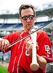 6 June 2010: Violinist Glenn Donnellan, a musician with the National Symphony Orchestra, plays his custom-made Louisville Slugger electric violin-bat prior to a game between the Washington Nationals and the Cincinnati Reds at Nationals Park in Washington, DC. The Reds edged out the Nationals 5-4 in a ten inning game. Mandatory Credit: Ed Wolfstein Photo