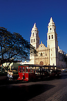 Tourist sightseeing trolley bus parked next to the Parque Principal in the city of Campeche, Mexico