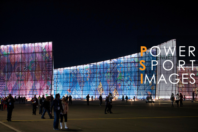 Visitos walk at night during the 2014 Sochi Olympic Winter Games at the Olympic Park on February 8, 2014 in Sochi, Russia. Photo by Victor Fraile / Power Sport Images