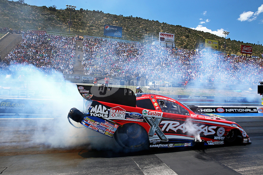 Jul. 21, 2013; Morrison, CO, USA: NHRA funny car driver Courtney Force during the Mile High Nationals at Bandimere Speedway. Mandatory Credit: Mark J. Rebilas-