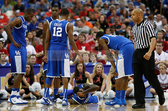 Doron Lamb sustains an injury in the final minutes of the 2011 SEC Men's Basketball Tournament semifinal game between Kentucky and Alabama, played at the Georgia Dome, on Saturday, March 12, 2011.  Photo by Latara Appleby | Staff