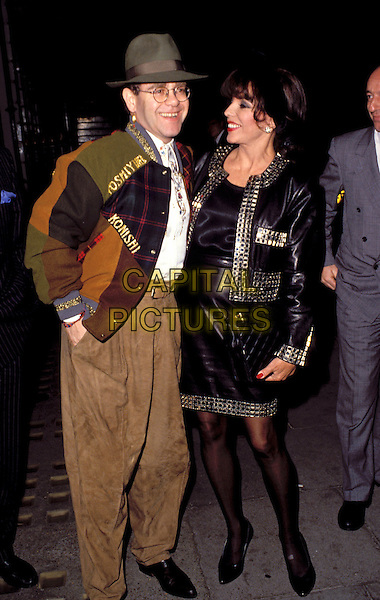 ELTON JOHN & JOAN COLLINS .Ref: 007.eighties fashion.www.capitalpictures.com.sales@capitalpictures.com.© Capital Pictures