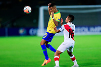 ARMENIA, COLOMBIA - JANUARY 19: Brazil's Reinier fights for the ball against Peru's Jesus Pretell during their CONMEBOL Pre-Olympic soccer game at Centenario Stadium on January 19, 2020 in Armenia, Colombia. (Photo by Daniel Munoz/VIEW press/Getty Images)