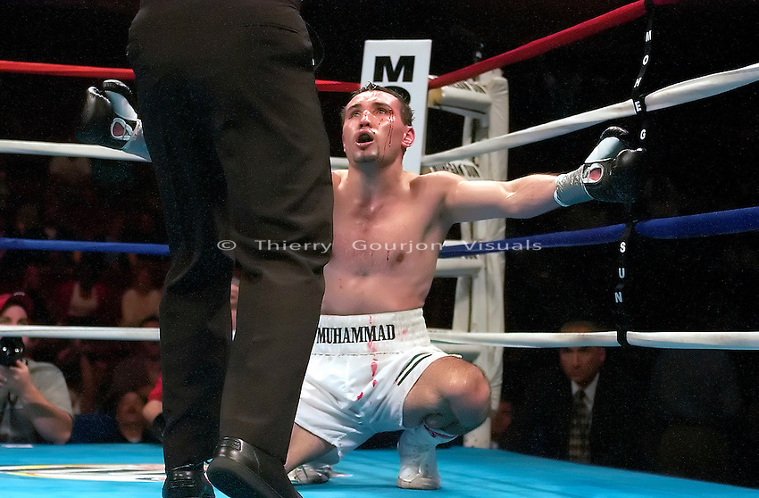 Muhammad Abdullaev (white trunk) argues with the referee after being counted out during his 10 round Junior Welterweight fight  against Emmanuel Clottey  at the Mohegan sun Casino on June 3rd, 2003. Clottey won by TKO in the 10th round.