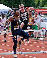 John Burroughs High School senior Ezekiel Elliott clears the final hurdle on his way to victory in the Class 3 Boys 300 meter Hurdle final while Cassville's Cody Frana (1195) chases, on his way to a runner-up finish. Elliott finished in 39.01 while Frana finished in 39.66.