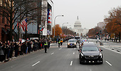 People line Pennsylvania Ave. as the hearse passes by carrying the flag-draped casket of former President George H.W. Bush as it drives away from the Capitol heading to a State Funeral at the National Cathedral, Wednesday, Dec. 5, 2018, in Washington. <br /> Credit: Alex Brandon / Pool via CNP