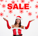 USA, Illinois, Metamora, Woman wearing Santa costume looking at sale sign