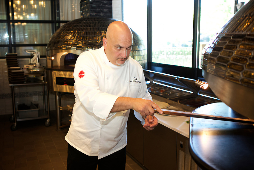 Queens, NY - July 9, 2017:  Corporate Chef Steve Koutsoumbaris  in the kitchen at Allora Italian Kitchen and Bar in Bayside.<br /><br /><br />Credit: Clay Williams for Edible Queens.