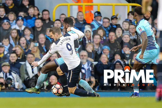 Vincent Janssen of Tottenham Hotspur (9) and Aaron Pierre of Wycombe Wanderers (2nd left) battle during the FA Cup 4th round match between Tottenham Hotspur and Wycombe Wanderers at White Hart Lane, London, England on 28 January 2017. Photo by PRiME Media Images / David Horn.
