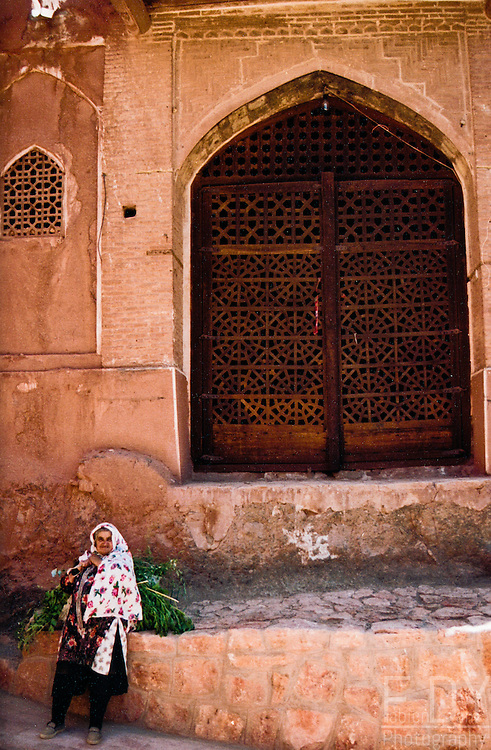 A woman in the streets of Abyaneh village, not far from Natanz, Iran