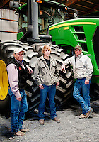 From left, Terry Frische (cq), Clark Frische (cq), and Myles Frische (cq) in front of their tractor at their cotton farm in Dumas, Texas, Tuesday, February 15, 2011. With the high price of cotton in recent years, many farmers in the area have switched to start farming cotton...Photo by Matt Nager