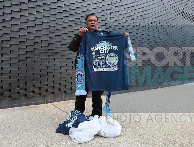 Champions t-shirts on sale during the premier league match at the Etihad Stadium, Manchester. Picture date 22nd April 2018. Picture credit should read: Simon Bellis/Sportimage