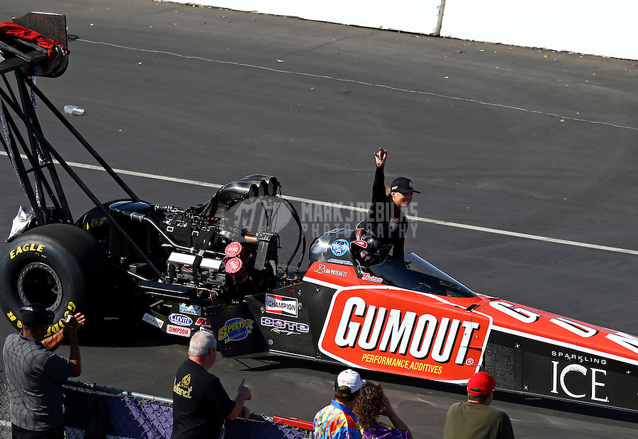 Feb 8, 2015; Pomona, CA, USA; NHRA top fuel driver Leah Pritchett on the return road waving to the crowd during the Winternationals at Auto Club Raceway at Pomona. Mandatory Credit: Mark J. Rebilas-