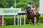 HONG KONG - MAY 04:  (L) Joao Moreira of Portugal riding Tour De Four competes with Douglas Whyte of South Africa riding Gorgeous Debut during  the Admiralty at Sha Tin racecourse on May 4, 2014 in Hong Kong, Hong Kong.  Photo by Aitor Alcalde / Power Sport Images