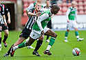 HIBERNIAN'S ISAIAH OSBOURNE CATCHES PARS RYAN THOMSON WITH HIS ARM