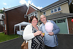 Redrow Homes Meet The Neighbours event at Parc Heol Gerrig, Merthyr Tydfil..Paul Wills & Kim Bennett outside their new home..25.05.13.©Steve Pope