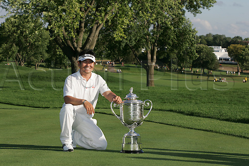16 August 2009: Y.E. Yang of South Korea holds the Wanamaker Trophy after winning the 91st PGA Championship at Hazeltine National Golf Club in Chaska, Minnesota.(Photo: Charles Baus/ActionPlus) UK Licenses Only