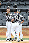 21 May 2016: Wake Forest's Stuart Fairchild (4) celebrates his home run with Will Craig (left) and Nate Mondou (right). The Wake Forest University Demon Deacons played the University of Louisville Cardinals in an NCAA Division I Men's baseball game at David F. Couch Ballpark in Winston-Salem, North Carolina. Louisville won the game 9-4.