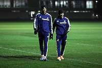 L-R: David Ngog and Jonathan de Guzman of Swansea arriving at the training ground