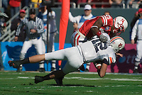 01 January 2007: Auburn quarterback Brandon Cox (#12) is sacked for a loss by Nebraska defender Andre Jones (#25) during the 2007 AT&T Cotton Bowl Classic between The University of Auburn and The University of Nebraska at The Cotton Bowl in Dallas, TX.