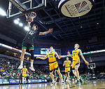 SIOUX FALLS, SD - MARCH 10: Filip Rebraca #12 of the North Dakota Fighting Hawks dunks past North Dakota State Bison defenders during the men's championship game at the 2020 Summit League Basketball Tournament in Sioux Falls, SD. (Photo by Richard Carlson/Inertia)