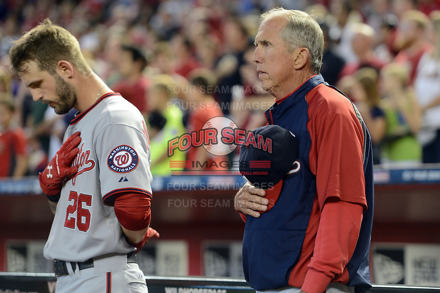 Washington Nationals outfielder Jeff Kobernus (26) and manager Davey Johnson (5) during the national anthem before Johnson's last game, announcing his retirement, against the Arizona Diamondbacks at Chase Field on September 29, 2013 in Phoenix, Arizona.  Arizona defeated Washington 3-2.  (Mike Janes/Four Seam Images)