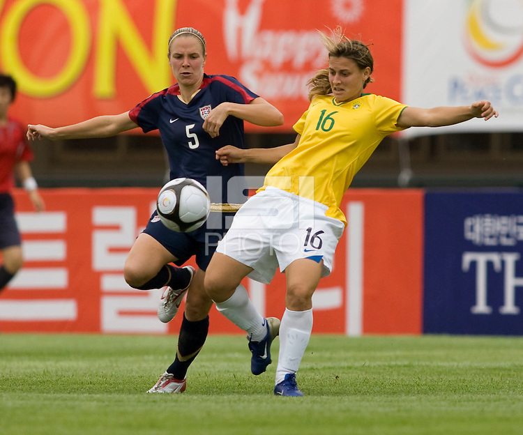 USWNT midfielder (5) Lindsay Tarpley has the ball cleared away from her by  Brazil's (16) Daiane Rodrigues during the second group game of the Peace Queen Cup.  The USWNT defeated Brazil, 1-0, at the Suwon Sports Complex in Suwon, South Korea.