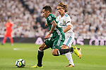 Real Madrid's Luka Modric and Real Betis's Cristian Tello during La Liga match between Real Madrid and Real Betis at Santiago Bernabeu Stadium in Madrid, Spain September 20, 2017. (ALTERPHOTOS/Borja B.Hojas)